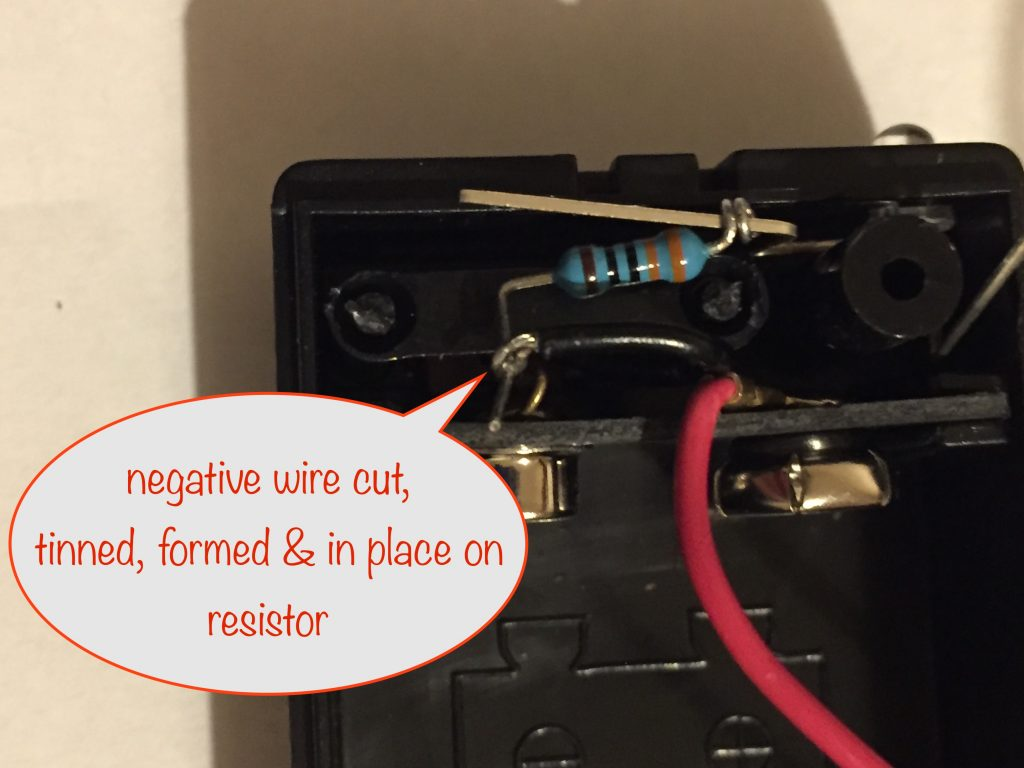 attaching the negative wire to the resistor