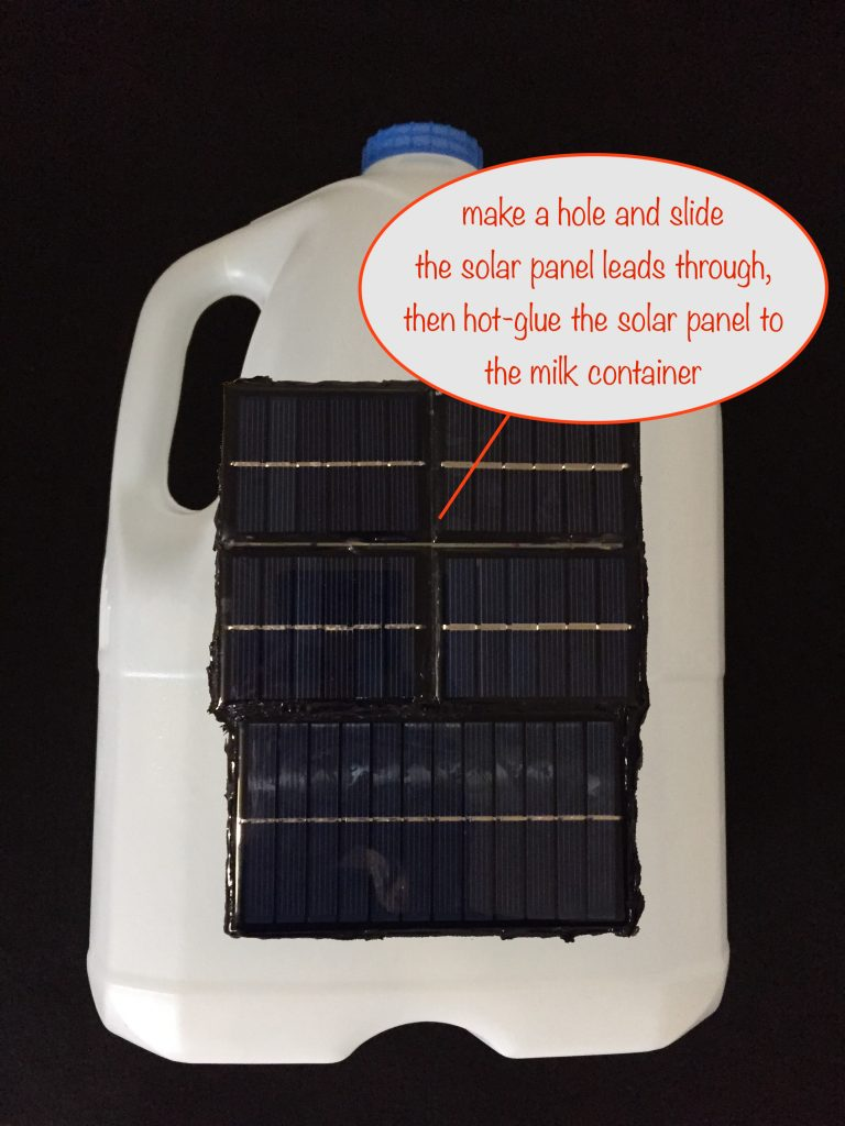 photo showing the solar panel hot-glued to the milk container